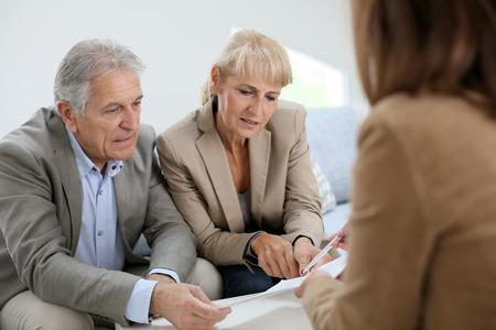 senior couple meeting real estate attorney